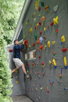 This would be cool!! Not exactly practical, but cool. ;) Home Rock Climbing Wall - by Elevate Climbing Walls