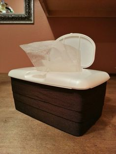 Dryer sheet dispenser container - made from a baby wet wipes box & ribbon.