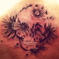 between my shoulder blades- skull with flowers