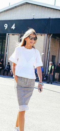 Sarah Rutson in a white top and grey skirt