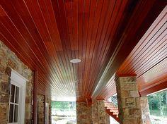 dekdrain under deck waterproofing system in a dark wood color - Wood Under Porch Ceiling