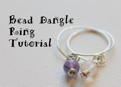 How to Make a Bead Dangle Wire Ring.  Super cute, easy and stackable!  Click to get the step by step tutorial with photos and videos, too!  #rings #jewelrymaking http://kimberliekohler.com/5100/how-to-make-a-bead-dangle-wire-ring/