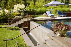 Add flower containers along the pool stairway if possible. Another idea is to stagger flower containers on each step of the stairs for a dramatic look.