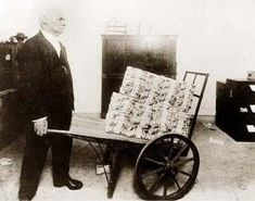 Image result for images of people using wheelbarrows to transfer cash to buy bread