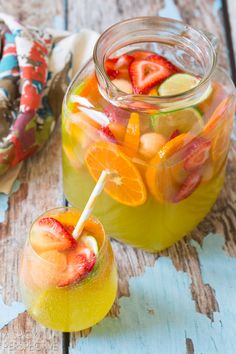 Best White Sangria with Melon, Ginger Liqueur and Berries! #sangria #summer #cocktails #party