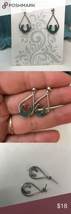 Lucky horse shoe pierced earrings. Silver colored metal teardrop shaped pierced earrings with little silver colored horseshoes with turquoise looking stones. These are stamped SF on back of each earring and locks for posts say surgical on backs. I think these might be Marjorie Baer but can't be certain. Top of post to bottom of earring is just over an inch long. Jewelry Earrings