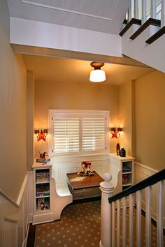 What an amazing use of space! A large stair landing or an underutilized nook in your home can transform into the ideal homework area with a diner booth setup. The built-in bookcase is a perfect place for stashing a dictionary, a thesaurus and a good atlas.