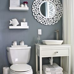 New hex marble tile floors, a mosaic inlay, and new fixtures including a DIY vanity with vessel sink transformed this dumpy, dated bathroom into a crisp, fresh space. See the rest of the photos here. | thisoldhouse.com/yourTOH