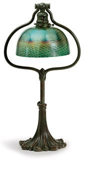 TIFFANY STUDIOS   A Favrile Glass and Bronze Adjustable Desk Lamp, circa 1910   21¾ in. (55.3 cm.) high, 8¼ in. (21 cm.) diameter of shade