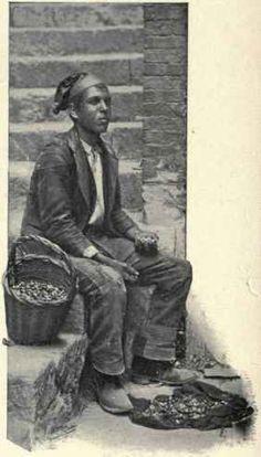 Sea-snail vendor in traditional dress, in Girgenti (Agrigento in Italian), circa 1920.  Sicily