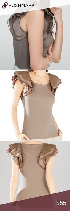 BCBGMAXAZRIA Mirabelle top Beautiful Brown fitted tank. Gorgeous Layered sleeves!!! Ruffles & pleated. Goes great with high waisted bottoms! 🙌💗 A few stains as pictured but are not too noticeable, & trust me... they will be too busy looking at your sleeves to notice!❤️😍 Worn only a few times. BCBGMaxAzria Tops Tank Tops