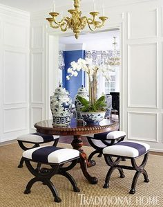 """English antique benches covered in Kravet's """"Madison Linen"""" cluster around an 1800s table. Via TraditionalHome"""