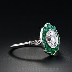 Deco 1 ct. oval diamond and emerald ring in its original platinum setting, which dates back to the 1930s