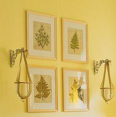 Pressed flowers/leaves on burlap in inexpensive frames.