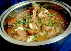 Murg Badami is an almond based gravy dish which is made with almond and poppy seeds paste, flavored with cardamom powder and whole spice powder. This is an easy but creamy and spicy gravy based chicken recipe. Usually cook with sliced onions but I used boiled onion puree that gives a nice creamy taste. You can use sliced onions or simple onion paste. ServeMurg Badami Recipe with Lachha Paratha Recipe for lunch. Here are a few more chicken delicacies that you will also love...