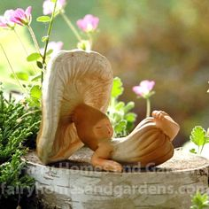 This sleepy little shroom baby is ready for a nap in your miniature fairy garden. Miniature Fairy Figurines, Miniature Fairy Gardens, Baby Fairy, Love Fairy, Magical Monster, Biscuit, Pottery Animals, Tree Faces, Snow Fairy