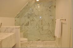 Shower design with a sloped ceiling
