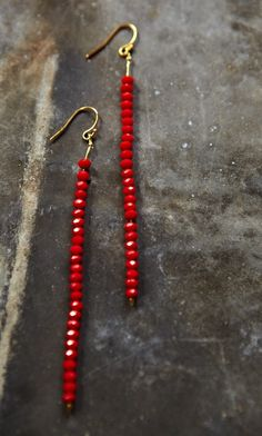 Tao Earrings.      Ultra sophisticated bead drop earrings. True red facetted beads with 18k gold plated hooks.