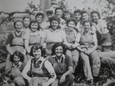 Members of the Timber Corps taking a break from their hard work to pose for a group photo, 1940s. #vintage #1940s #WW2 #women #Lumber_Jills