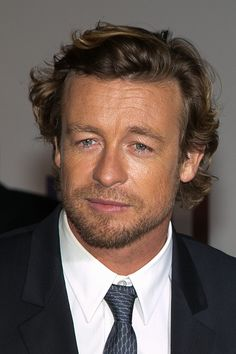 Actor Simon Baker attends the 'MENTALIST' photocall at TF1 TV studios on February 6 2015 in Paris France