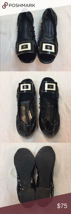 Tory Burch black patent leather peep toe flats Tory Burch black patent leather peep toe ballet flats. Black cream and gold rectangular logo. Great condition! No size is indicated on shoe but they are a size 7. Great condition! Minor buckling on inside sole of the left shoe as shown in photo. Causes no discomfort when shoe is on. Very comfortable!! Tory Burch Shoes Flats & Loafers