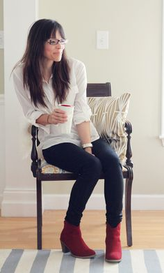 Red boots. navy skinnies. white loose shirt. watch.  Red shoes/boots always look good with monotones as well.