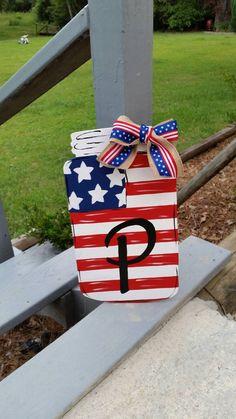 Items similar to Mason jar door hanger on Etsy Wooden Door Hangers, Wooden Doors, Wooden Signs, Red Mason Jars, Painted Mason Jars, Door Crafts, Fourth Of July Decor, July 4th, Patriotic Decorations