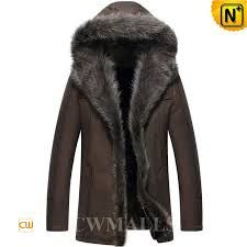 Smooth and durability hooded sheepskin coat with fur trim made of deliciously warm and supple Australian sheepskin shearling. Either way you wear it, generous fit raccoon fur trims the hood and front, button front, with slip pockets on either side. Men's Leather Jacket, Shearling Jacket, Fur Jacket, Fur Trim Coat, Fur Coats, Mens Fur, Sheepskin Coat, Parka Coat, Ice Age