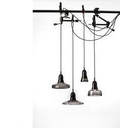 Autory skleněných závěsných svítidel Shadows, pro českou značku Brokis,  je designérská dvojice Lucie Koldová a  Dan Yeffet. Svítidla byla na jaře představena V Miláně v rámci veletrhu Salone del Mobile a v Praze jste je mohli vidět na letošním Designbloku.
