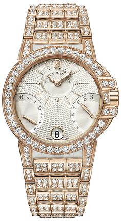 This watch features: Polished finished 18kt Rose Gold case and bracelet.  White rubber end links & alternating center links. Bracelet pavé set with Diamonds. Bezel & lugs set with 57 brilliant- cut Diamonds (approx.2.46 carats). Dial set with 3 Diamond hour markers (approx.0.01 carats). Bracelet set with 372 brilliant- cut Diamonds (approx. 5.45 carats). Silver guilloché textured main  dial. Flat silver sub-dials.