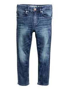 Check this out! Extreme Flex. Super skinny-fit jeans in superstretch, flexible denim for improved movement. Adjustable elasticized waistband and zip fly with snap fastener. - Visit hm.com to see more.