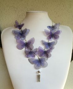 Completely hand-made necklace, with silk organza butterflies and glass vials with real dried lavender flowers.  I chose butterfly images one by one, from real pictures and vintage illustrations. Then I printed them on high quality silk organza, cut, sealed to prevent fabric frying and fixed on silver chain.  Feminine.. ethereal.. light.. and romantic. Simply beautiful! OOAK  I love to create these unique pieces of jewelry. Please pay attention when you wear the necklace. It is very…