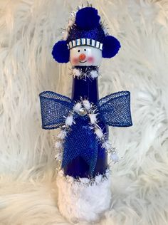 A personal favorite from my Etsy shop https://www.etsy.com/listing/559667336/blue-snowman-lighted-bottle-snowman