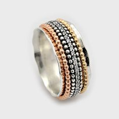 Spinner fidget Multi color ring mixed with Sterling Silver yellow gold filled and rose gold filled spinning ring sets with CZ Stones around it Width: 0.5 Inch Weight: 15 grams Thickness: 1.3mm Here you can find our silver and gold spinning rings collection https://www.etsy.com/shop/ByNatureJewellery/items?ref=hdr_shop_menu§ion_id=16670263
