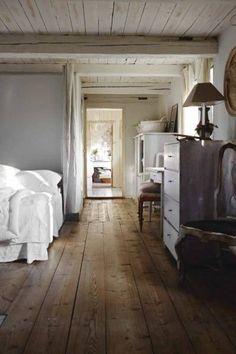wooden floor bedroom - love the ceiling & beams too!