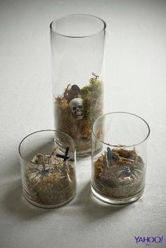 This year bump your Halloween décor up a notch, and ditch the floral centerpiece. Turn mix-matched sets of mason jars and glass vases into your very own mini-indoor DIY graveyard.
