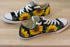 These custom painted authentic Converse All-Star low top sneakers feature a colorful Sunflower floral print design. This design is hand-painted using permanent acrylic paints and artist markers, and can be recreated or color-customized to meet your specifications. This design can be painted on any canvas shoe style and color you desire!  The price includes the shoes themselves and the artwork. When ordering these shoes please include the following information: 1. Shoe size 2. Shoe color and…