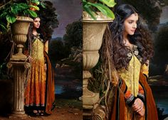Elegant and Graceful Printed Georgette Party Wear Anarkali Suit in Shaded Golden Yellow With Black Jacket . Comes along with Santoon bottom and matching Rust colored chiffon dupatta.