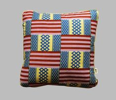 Cushion Beach House is a square cushion made with African wax Kente fabric and comes with a removable cover and duck feather cushion pad. The mix of cream, sea blue, red and pink make a summery combination!