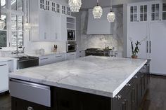 Kitchen full of Carrara and Chandeliers...my DREAM!