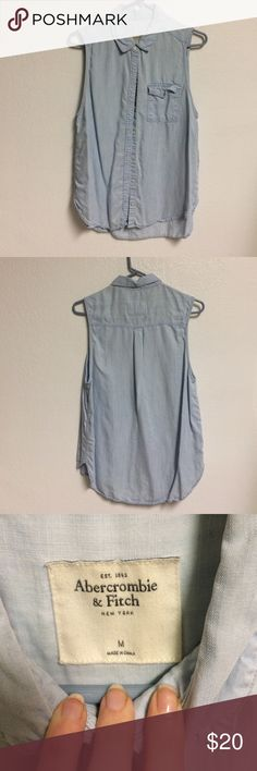 Abercrombie sleeveless chambray button down Excellent used condition. No flaws. Button pocket detail in front. Really soft cotton fabric. Goes with anything. Great for spring and summer Abercrombie & Fitch Tops Button Down Shirts