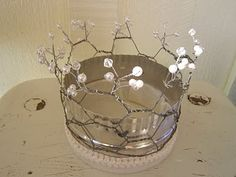 Upcycled crown made from dryer vent, chicken wire. felt and beads.