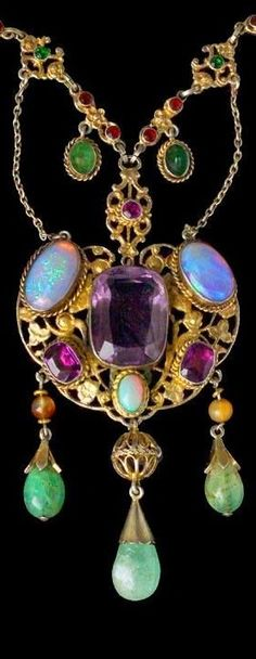 AUSTRO HUNGARIAN Necklace Gilded silver Amethyst Opal Emerald Agate Paste Pendant: H: 10 cm in) W: cm in) Necklace: L: 50 cm in) Marks: Dogs head & 'WM' Austro-Hungarian, Literature: cf. European Designer Jewellery, Ginger Moro, p. Antique Brooches, Antique Jewelry, Vintage Jewelry, Art Nouveau Jewelry, Amethysts, Emeralds, Statement Jewelry, Jewelry Crafts, Gemstone Jewelry
