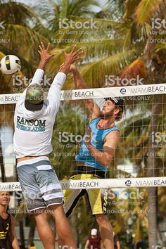 A Man Jumps To Spike The Ball Past A Defender S Outstretched Arms In Miami Beach Miami Spikes