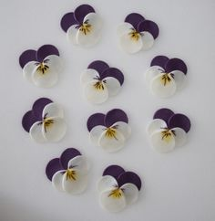 pansies made with circle punch. How pretty are these and a simple circle punch is all you appear to need.