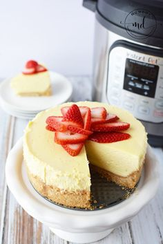 Instant Pot Cheesecake with strawberries is a classic cheesecake recipe that is so easy! Top with strawberries, raspberry puree, or even doused in chocolate and caramel. You won't mind tossing the no baked recipe when your Instant Pot does all the work.