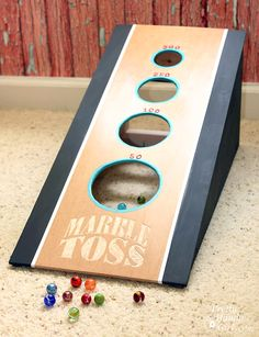 A fun DIY marble toss game that will keep the kids busy for the rest of the summer. An easy game to make using workshop scraps and a Dremel Fortiflex. #DremelMaker