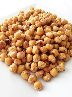 Ingredients: 2 (14.5 Oz.) Cans Chickpeas/Garbanzo Beans, Drained, Rinsed & Dried 2 Tbsp. Shredded Dry Parmesan 1 Tsp. Dried Crushed Rosemary 1 Garlic Clove, Minced 1/8 Tsp. Garlic Powder Salt & Pepper to Taste  Directions: Preheat the oven to 400 degrees F. and line a baking sheet with foil. Give the foil a light spritz of some non-stick cooking spray and set aside.