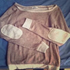 Tan long sleeve shirt w/elbow patches It's mostly brown/tan except for the neckline, wrists, bottom, and elbow patches which are a beige color. Very cute & soft. Size medium more like a small, could fit an extra small. Hardly been worn-great condition! dELiAs Sweaters Crew & Scoop Necks