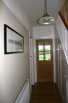 Walls Farrow and Ball 'Oxford Stone' Light by Jim Lawrence. (Mirrored on the Upstairs landing)